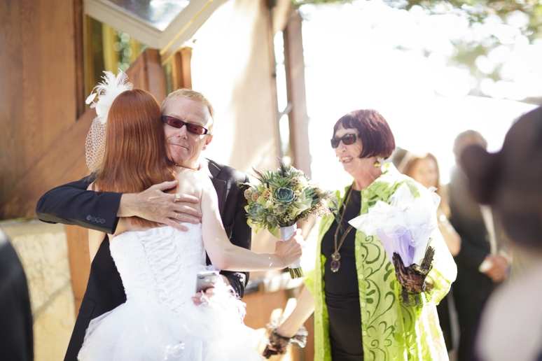 Los Angeles Palos Verdes Wedding Photographer Ceremony at Bride hugging David J at Wayfarer's Chapel