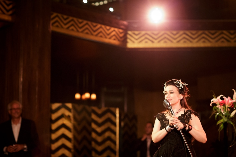 Downtown Los Angeles Wedding Photographer Rainbow Underhill singing at the 1928 Cicada