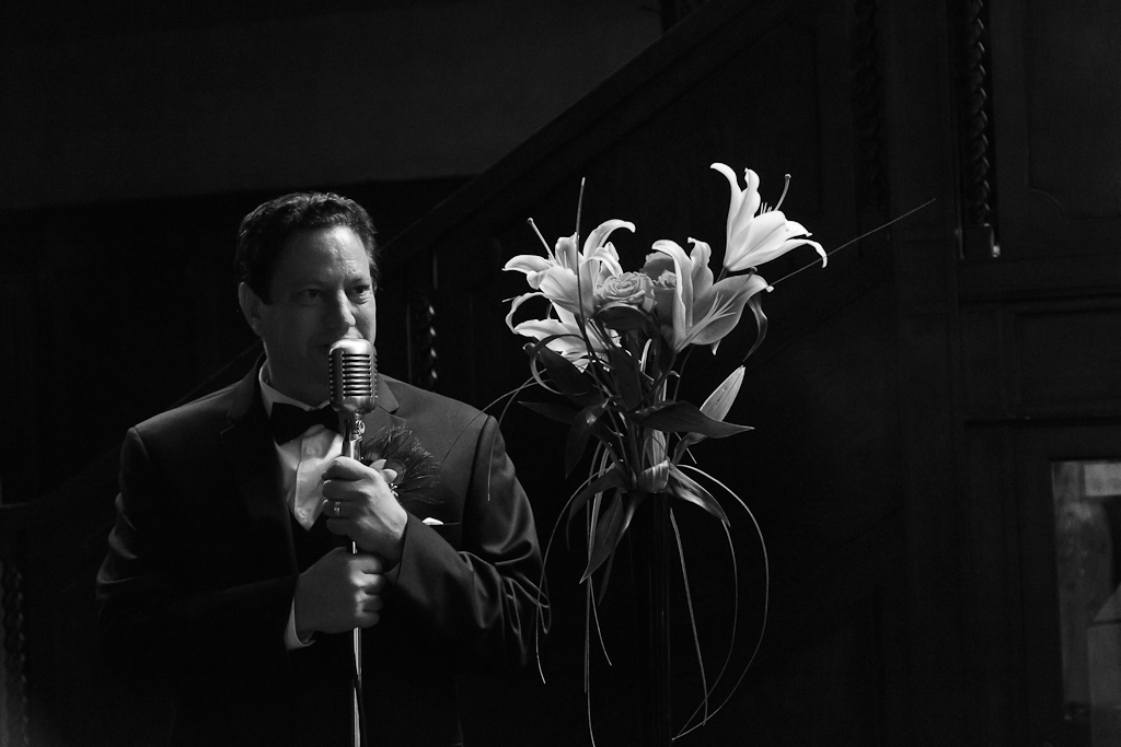 Downtown Los Angeles Art Deco Wedding Photographer Groom Giving Toast on Vintage Microphone at the Cicada