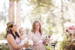 Bridesmaids in mismatched vintage dresses at the Castle House and Gardens in Santa Cruz