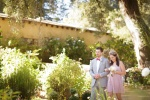 Bridesmaid and Groomsman coming down the aisle at the Castle House and Gardens in Santa Cruz