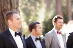 Candid shot of groom watching the bride coming down the aisle at the Castle House and Gardens in Santa Cruz