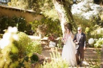Bride and her father walking down the aisle at the Castle House and Gardens