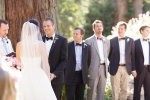 Bride and Groom exchanging vows under a redwood grove at the Castle House and Gardens in Santa Cruz