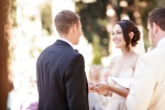 Santa Cruz Wedding Photographer Bride and Groom exchanging vows under a redwood grove at the Castle House and Gardens