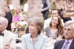 Santa Cruz Wedding Photographer bride's mom watching toasts at the Castle House and Ga