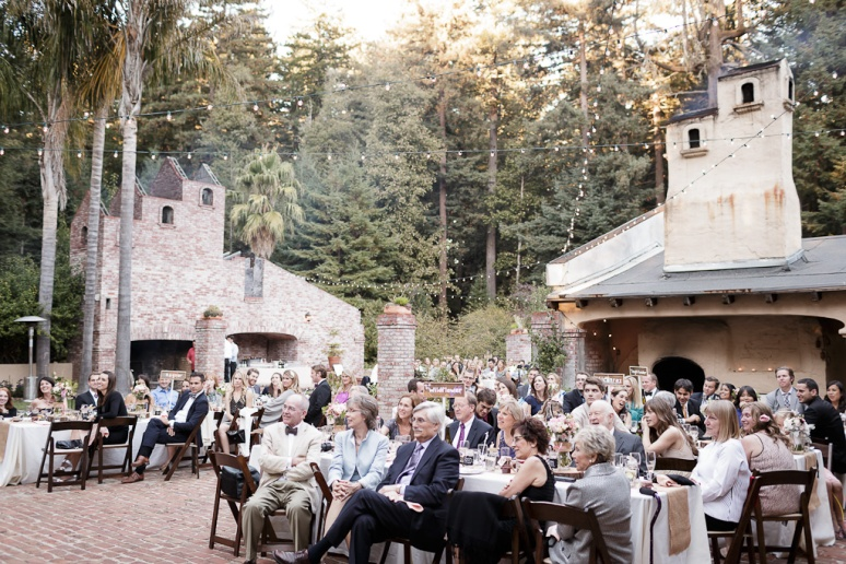 Santa Cruz Wedding Photographer guests watching toasts at the Castle House and Ga