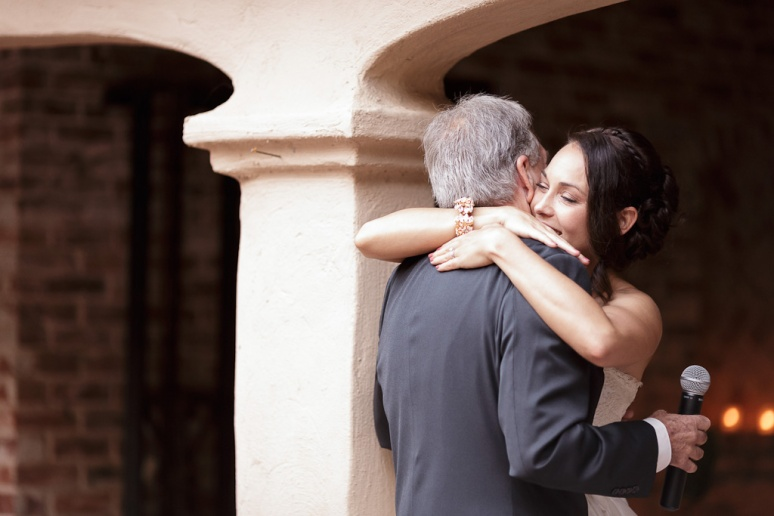 Santa Cruz Wedding Photographer bride hugging her father after his toast at the Castle House and Ga