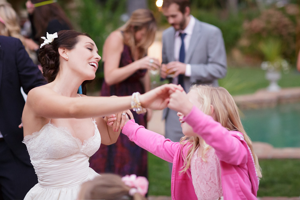 Bride Dancing with a flowergirl at the Guests Dancing at the Castle House and Gardens in Santa Cruz Wedding Photographer