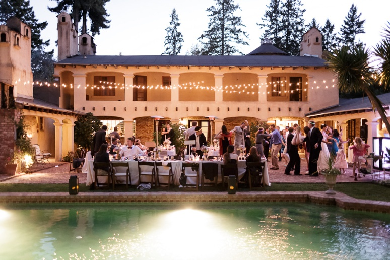 Patio of the Castle House and Gardens in Santa Cruz with String Lights Wedding Photographer