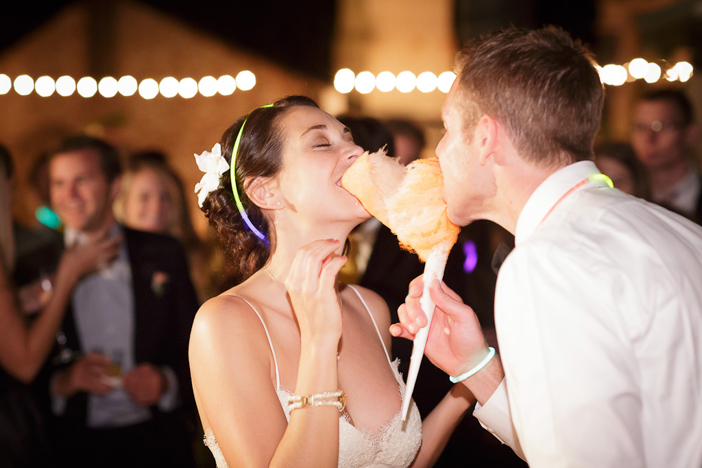 Bride and Groom sharing cotton candy at their wedding at the castle house and gardens in santa cruz