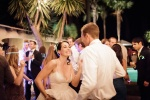 bride and groom dancing under string lights at the castle house and gardens in santa cruz