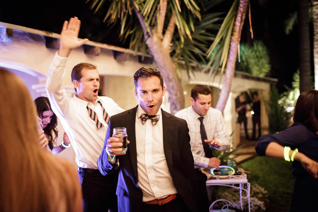 santa cruz wedding photographer guests dancing under string lights at the castle house and gardens