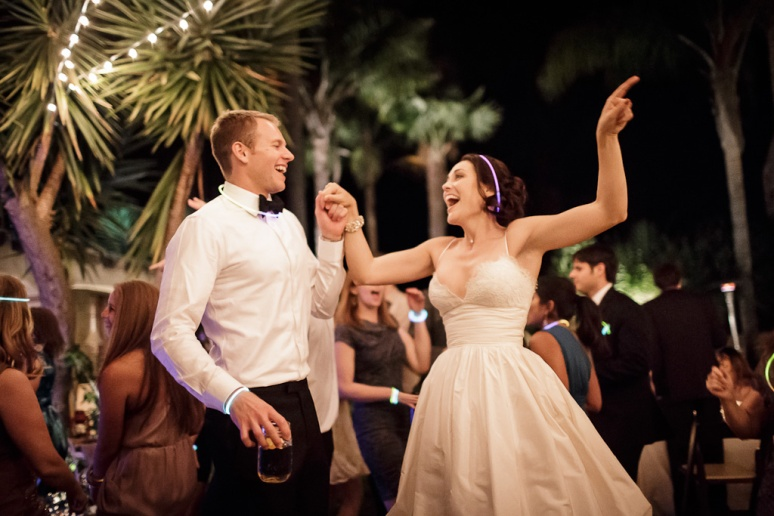 santa cruz wedding photographer bride and groom dancing under string lights at the castle house and gardens